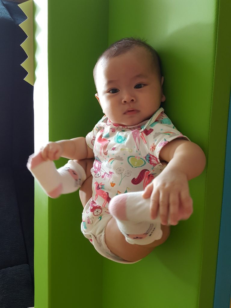 Enjoying her little space! The playmat is a mini playground for her, no other toys needed!