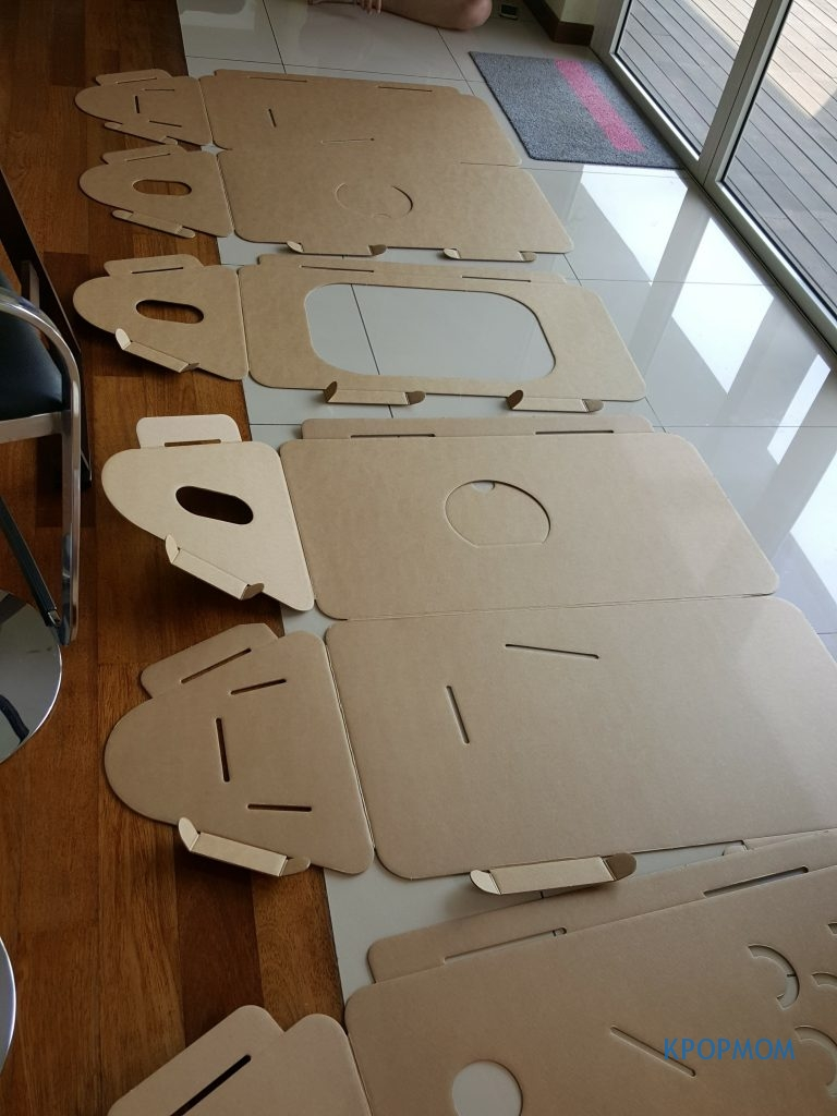 Then, lay the cardboard pieces flat as seen in the picture. It should be single, double, single and double.