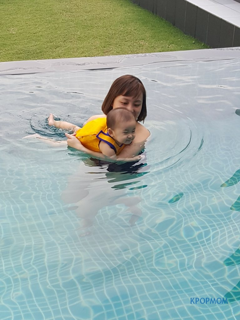 More of me coaching Arissa how to kick and kick in the water
