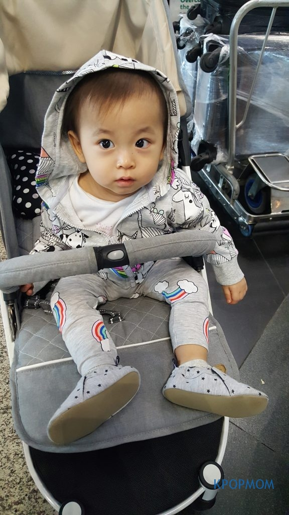 Baby A rocking her new shoes at KLIA airport