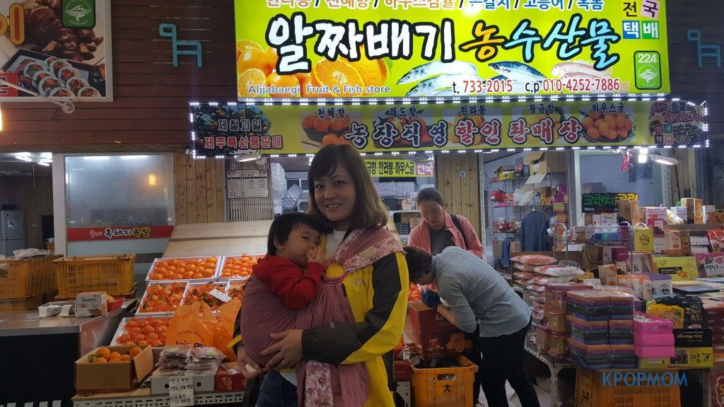 Jalan-jalan at the market. Baby A was just busy eating away...